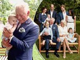 little louis affectionately grabs prince charles' face in never-before-seen photographs