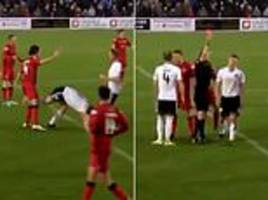 Scottish striker earns red card after kicking  opponent... and hitting him where it hurts