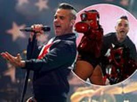 robbie williams puts on a passionate performance with scantily-clad dancers in mexico city