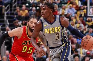 holiday leads pacers to 97-89 comeback win after oladipo leaves game