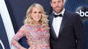 carrie underwood's husband mike fisher gushes over his wife after ceremony in her honor