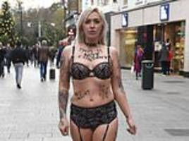Campaigner stands outside Dublin court in lingerie for consent protest 26284f139