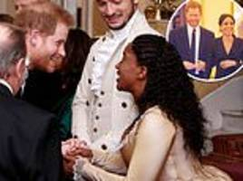 Harry and Meghan greet the cast of hit show Hamilton at the Royal Variety Performance
