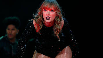Taylor Swift signs her first record deal with a major label