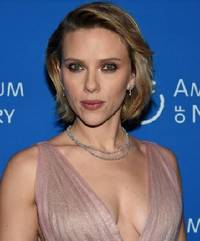 scarlett johansson wears platinum jewelry to the american museum of natural history gala