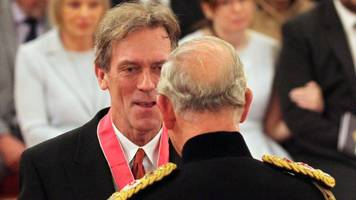 hugh laurie made a cbe by prince charles