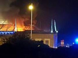 huge fire torches marquee in weston-super-mare where banksy built his dismaland theme park
