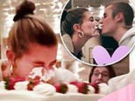justin bieber shoves wife hailey baldwin's face into birthday cake... before they share sweet smooch