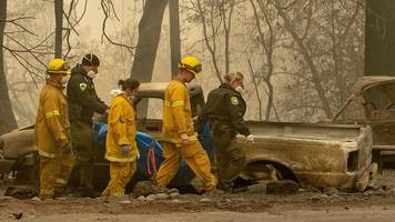 california wildfires: camp fire nearly fully contained