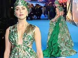 amber heard dazzles in plunging emerald gown and intricate headwear at aquaman premiere in london