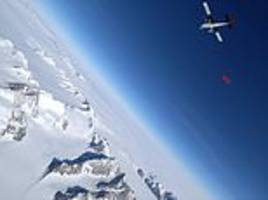 this is the moment a woman became the 'first' ever to wingsuit above icy mountains of the antarctica