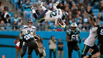 nfl: seattle seahawks' chris carson does 360 flip and carries on running