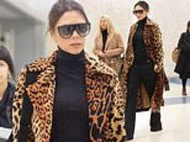 victoria beckham shows off her wild side in £2.5k leopard print coat and flares as she jets into nyc