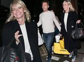 zoe ball can't wipe the smile off her face as she arrives at strictly's it takes two with her beau