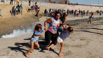 migrant caravan: trump defends tear gas on mexico border
