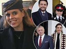 princess beatrice looks chic in a black coat and feathered hat at sandhurst