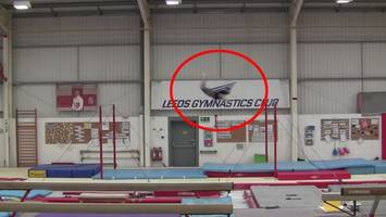 watch: gymnast sets world record for insane backflip between bars