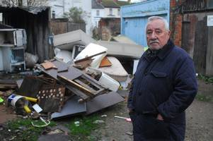 rats and needles have been found among this pile of waste in gloucester - and it hasn't been cleared for months