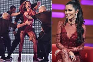 cheryl wows in sheer red jumpsuit as she confidently returns to stage to perform single