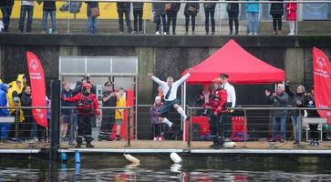splash: charity fundraisers take polar plunge into belfast's lagan