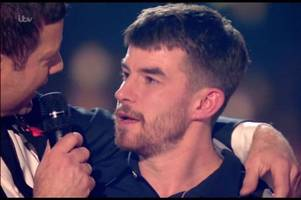 x factor 2018: robbie williams gives anthony russell a 'dire warning'
