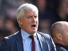 how the fire went out of sparky: mark hughes looked tired when the axe finally fell