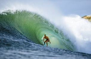 with olympics looming, surf star captures a bigger prize