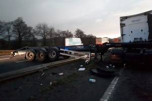pictures show m4 crash that left lorry strewn across central reservation