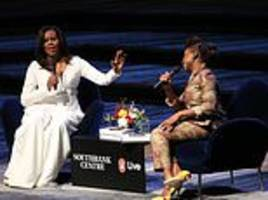 michelle obama tells book tour audience she is bidding to 'change the mindset of men'