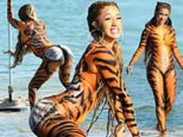 cardi b twerks on beach in tiger costume instead of attending court hearing