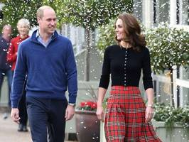 kate middleton looks festive in plaid skirt for christmas party