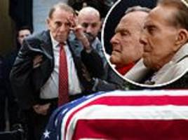 hero salutes hero: bob dole is helped out of his wheelchair so he could stand in tribute to bush
