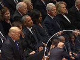 Hillary Clinton ignores Donald Trump as he and Melania arrive for front row seats for Bush's funeral