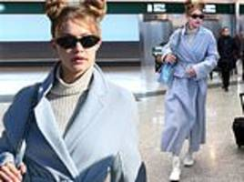 gigi hadid sports quirky space buns as she makes effortlessly stylish arrival in milan