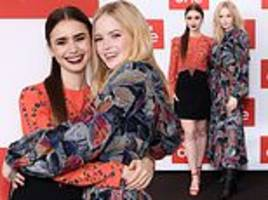 lily collins tenderly embraces co-star ellie bamber at les mis photocall