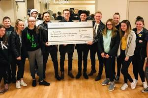 blantyre band make a £1.4k gift to terminal one