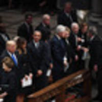 though trump sits at funeral with presidential predecessors, he stands alone