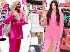 Kim Kardashian is a klone of Kylie Jenner as she copies younger sister's look in bright pink suit
