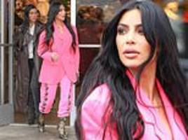kim kardashian rocks hot pink look while out shopping for christmas decorations with sister kourtney