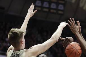 Edwards' late flurry leads Purdue past No. 23 Maryland 62-60