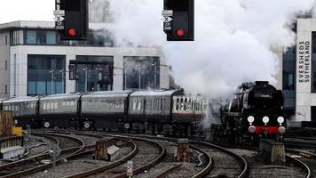 prince charles arrives at cardiff central on steam train