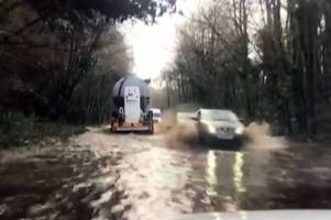 major road into cardiff left under water as heavy rain and flooding hits wales