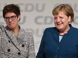 cdu party members quit in protest at angela merkel's successor as split widens in ruling party