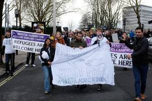 hundreds march through bristol city centre to condemn immigration detention system