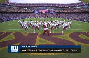 Santa Claus busts a move during Giants vs. Redskins