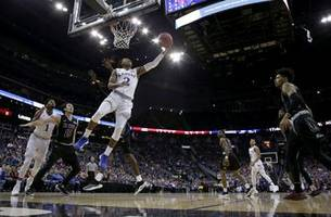 Lawson leads No. 2 Kansas past New Mexico State 63-60
