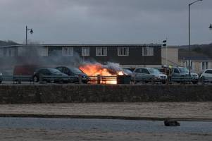 pictures show car destroyed in ball of flames in cornwall car park