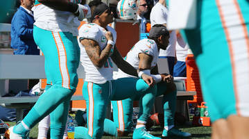 which nfl players protested racial injustice during the national anthem in week 14?