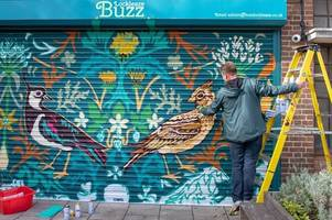 shop fronts in bristol neighbourhood get a makeover before hundreds of homes built in area