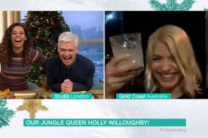 holly willoughby glugs down margarita in i'm a celebrity wrap interview with this morning's philip schofield